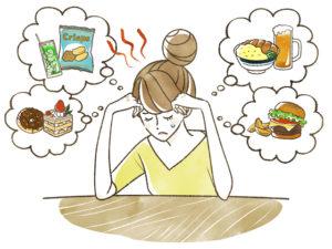 ダイエット中の食欲に耐える女性